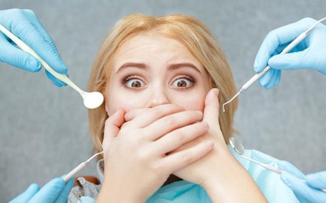 میزان درد در عمل عصب کشی دندان | نخ دندان مینا